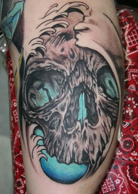 Grey Skull And Wave Tattoos