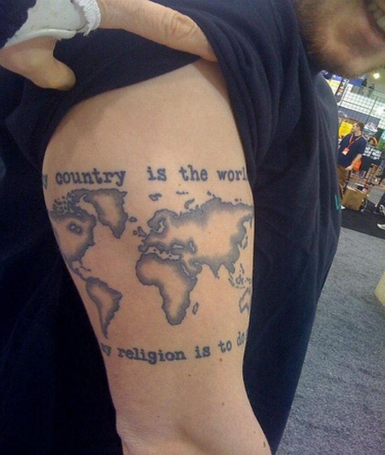 Grey World Map Tattoo On Biceps Of Guy