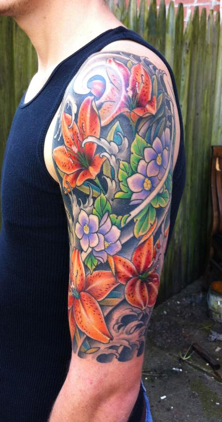 Half Sleeve Of Flowers And Wave Tattoos