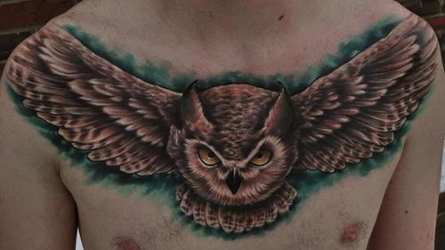 Horned Flying Owl Tattoo On Chest