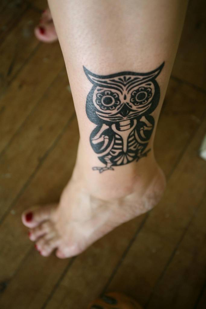 Horned Tribal Owl Tattoo On Lower Leg