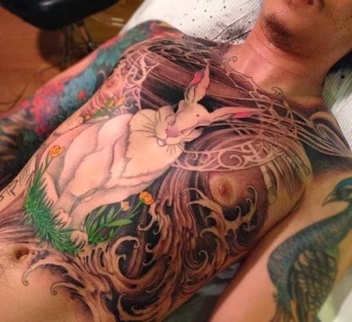 Huge Sitting White Rabbit Tattoo On Chest