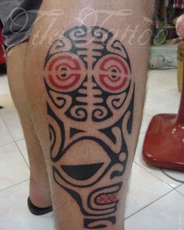 Impressive Black Polynesian Tiki Tattoo On Leg