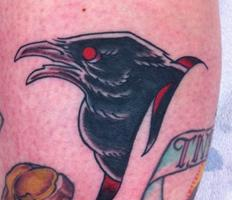 Impressive Crow Head Tattoo