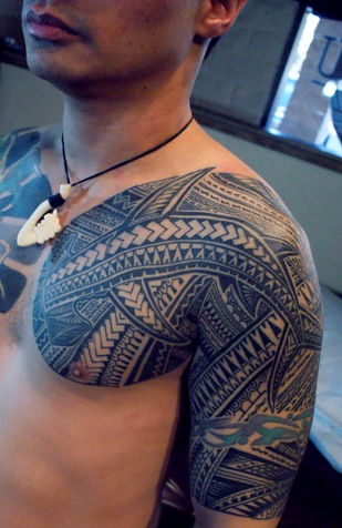 Impressive Polynesian Tattoos On Chest And Half Sleeve