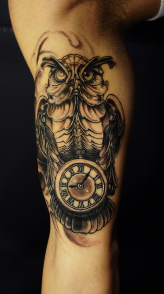 Incredible Biomechanical Owl Clock Tattoo On Arm