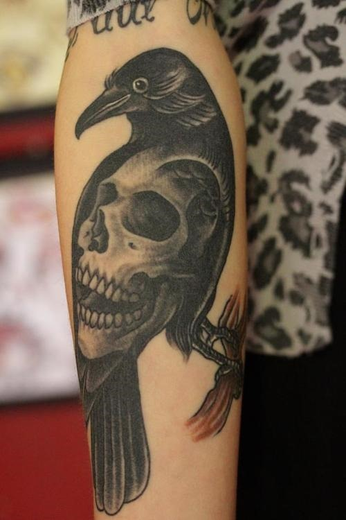 Incredible Crow Skull Tattoo On Arm