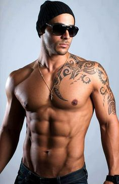 Incredible Polynesian Tattoos On Chest And Left Shoulder