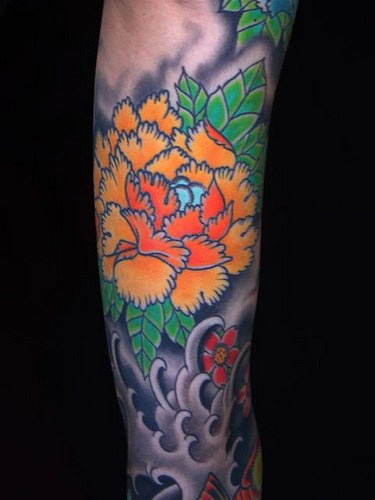Japanese Flower And Grey Waves Tattoos On Sleeve