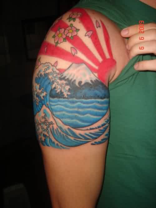 Japanese Sun Rays And Blue Wave Tattoos On Shoulder