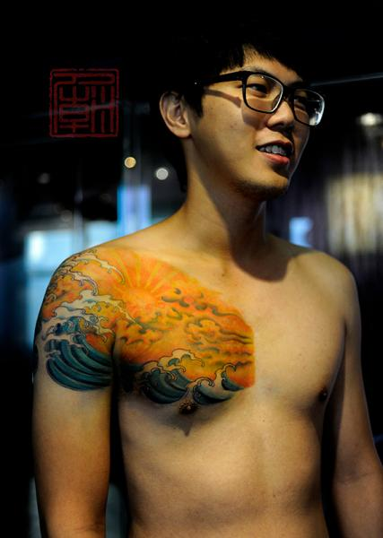 Japanese Waves Sun Tattoo On Chest For Boys