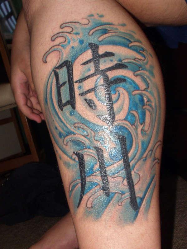Kanji Symbols And Blue Wave Tattoos On Leg