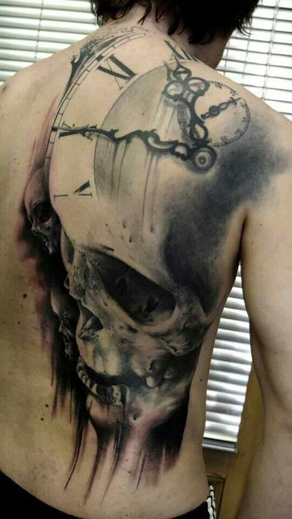 Large Clock Skull Tattoo On Half Back