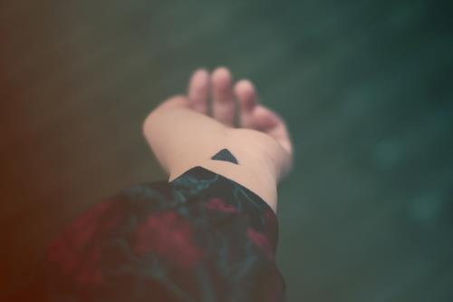 Little Black Ink Triangle Tattoo On Inner Wrist
