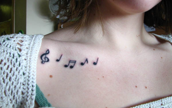 Little Music Note Tattoos On Right Collarbone