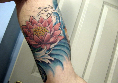 Lotus And Blue Ink Wave Tattoos On Arm