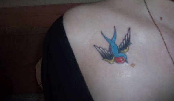 Lovely Bird Tattoo On Right Collarbone