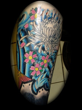 Lovely Blue Waves And Flower Tattoos
