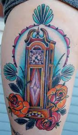 Lovely Clock Tattoo With Roses On Thigh