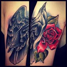 Lovely Crow And Red Rose Tattoos On Arm