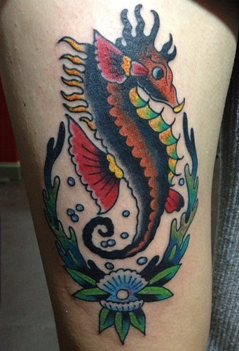 Lovely Seahorse And Flower Tattoos On Thigh