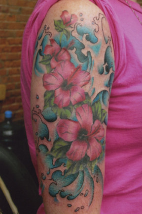 Lovely Water Waves And Flower Tattoos On Half Sleeve