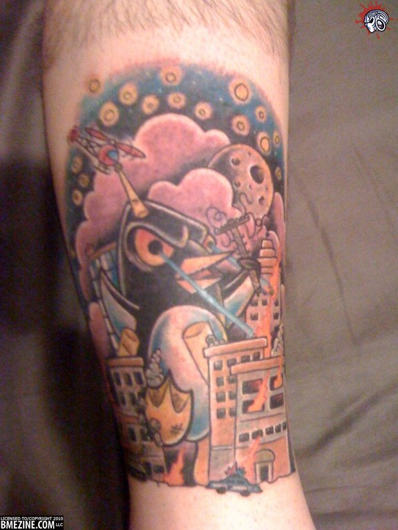Mad Cartoon Penguin Tattoo