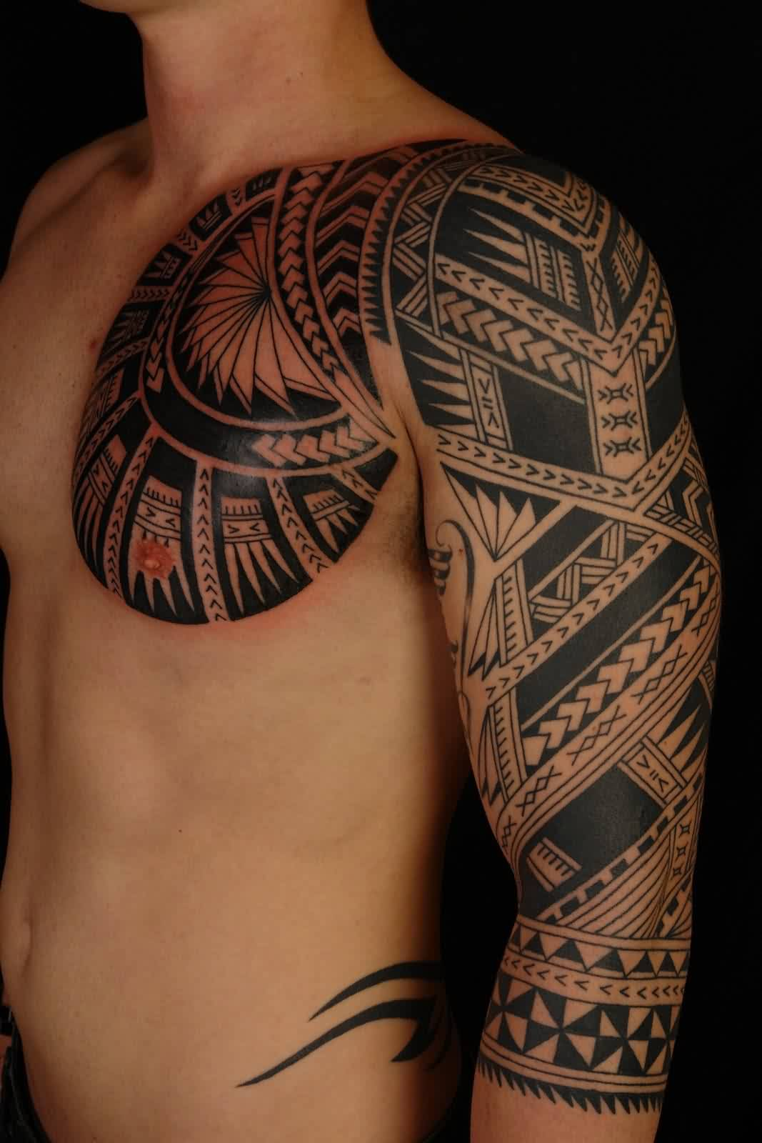 Maori Polynesian Tattoos On Chest And Left Sleeve