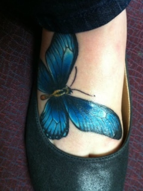 Marvelous 3D Blue Butterfly Tattoo On Foot