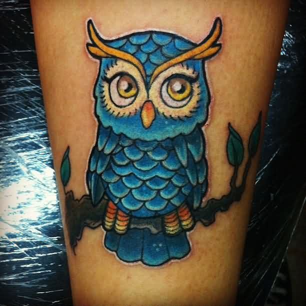 Marvelous Blue Owl On Branch Tattoo