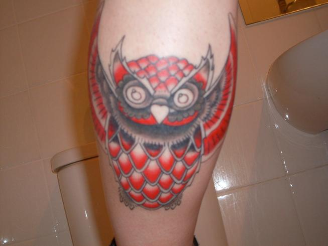Marvelous Red Owl With Open Wings Tattoo