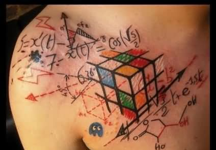 Maths And Colorful Puzzle Tattoos On Collarbone