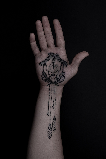 Nice Cuckoo Clock Tattoo On Palm