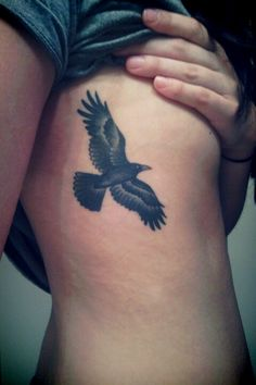 Nice Flying Crow Tattoo On Side