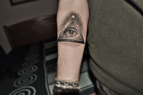 Nice Grey Ink Triangle Eye Tattoo On Forearm