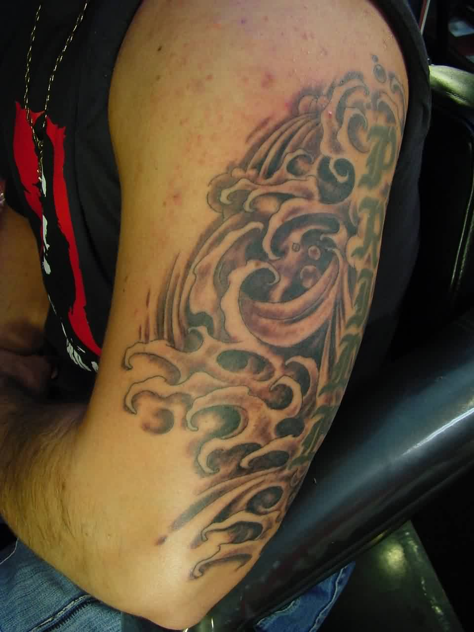 Nice Grey Wave Tattoo On Arm For Men