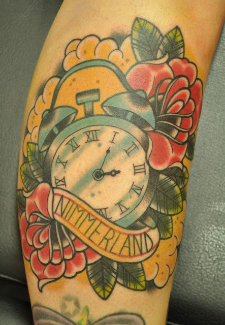 Nimmerland Clock And Rose Tattoos On Arm