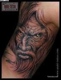 Old Warrior Face Tattoo On Biceps