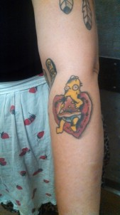 One Of My Coworkers Has An Awesome Tattoo Baby Homer Simpson Over A Heart Eating A Slice Of Pizza