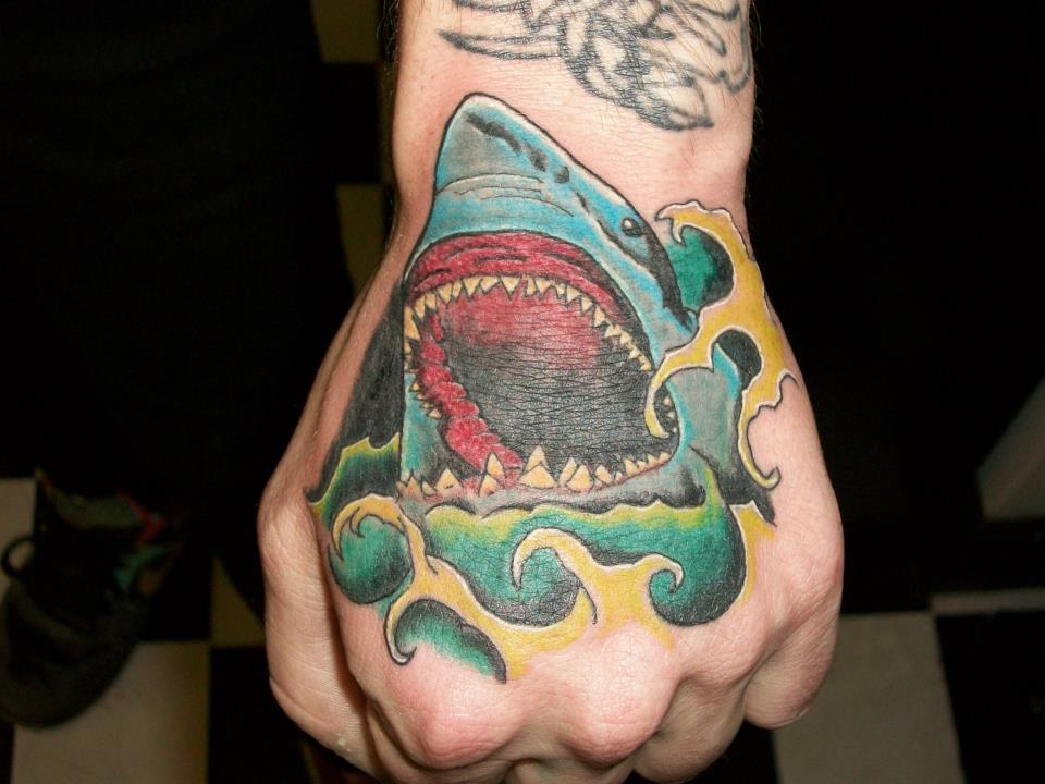 Open Mouth Shark And Wave Tattoos On Hand