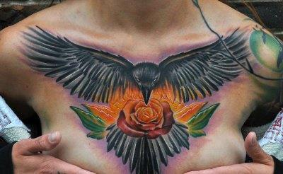 Open Wing Crow And Rose Tattoos On Chest
