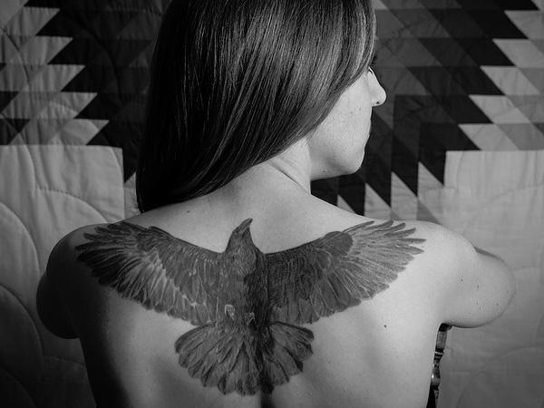 Open Wings Crow Tattoo On Upperback