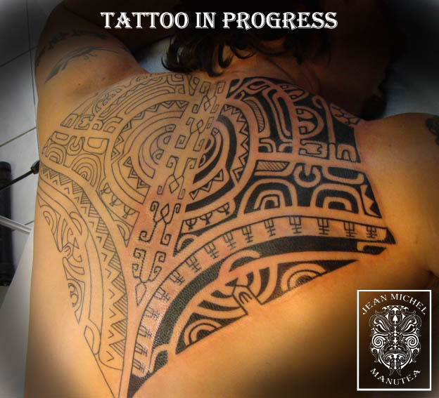 Outline And Black Polynesian Tattoos On Back