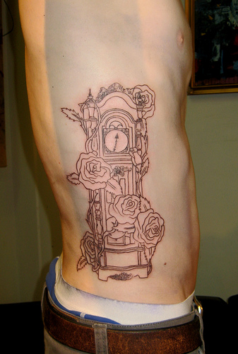 Outline Clock With Rose Tattoos On Rib
