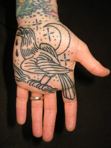 Outline Crow On Branch Tattoo On Palm