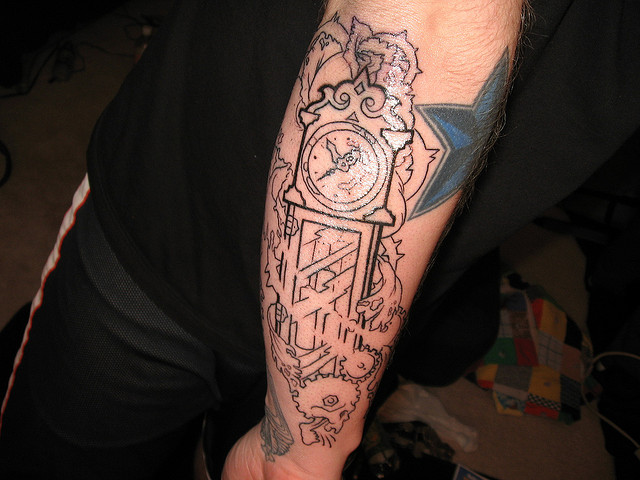 Outline Grandfather Clock Tattoo On Arm