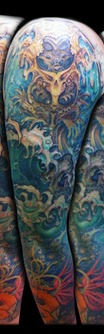 Outstanding Blue Waves Tattoos On Right Sleeve