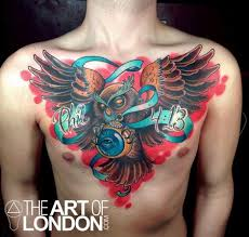 Owl And Blue Ribbon Tattoo On Chest
