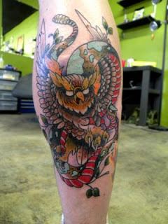 Owl And Snake Tattoos On Leg