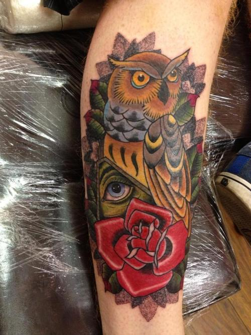 Owl Illuminati And Red Rose Tattoos On Leg
